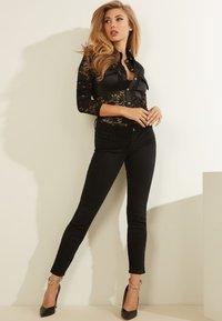 Guess - Button-down blouse - schwarz - 3