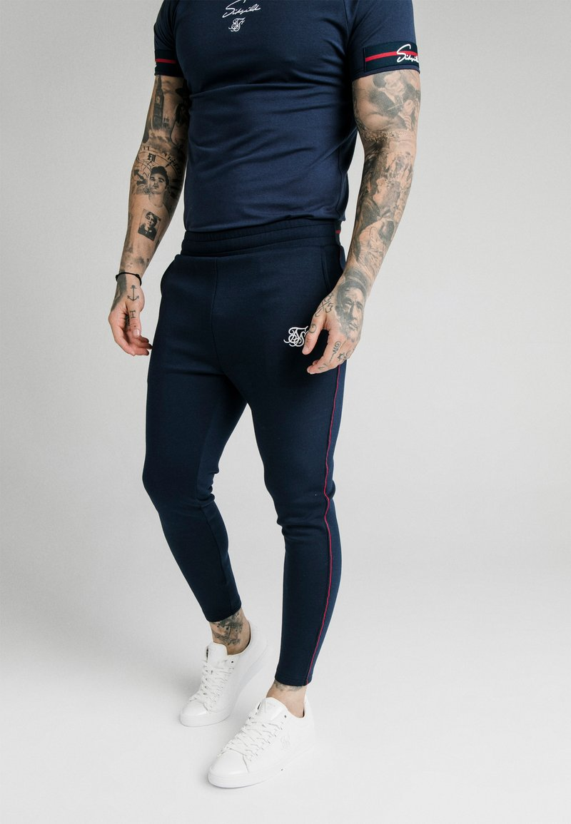 SIKSILK - EXPOSED TAPE JOGGER - Träningsbyxor - navy