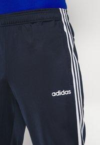 adidas Performance - 3 STRIPES SPORTS REGULAR PANTS - Teplákové kalhoty - legink/white - 4