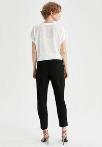 DeFacto - Trousers - black - 2