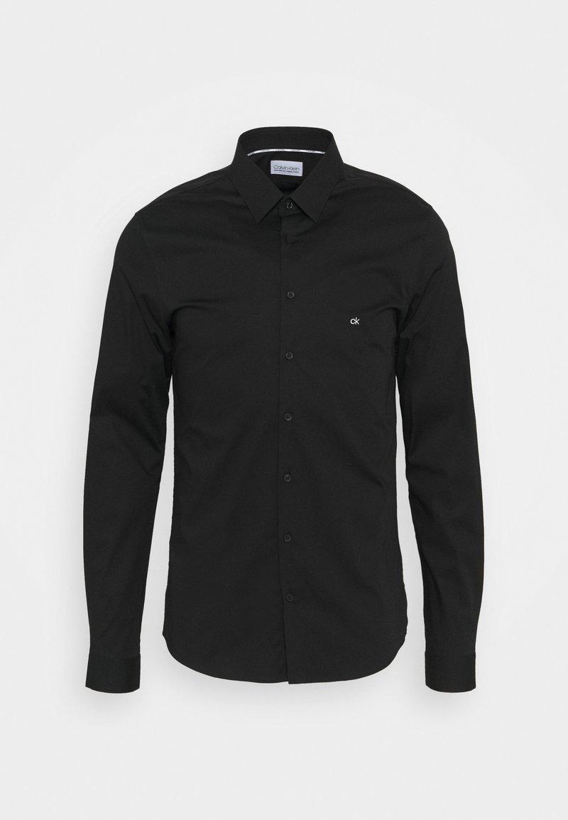 Calvin Klein Tailored - LOGO STRETCH EXTRA SLIM - Formal shirt - black