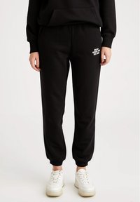 DeFacto - Tracksuit bottoms - black - 0