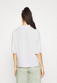 Vero Moda - VMWIGGA V NECK - Long sleeved top - bright white - 2
