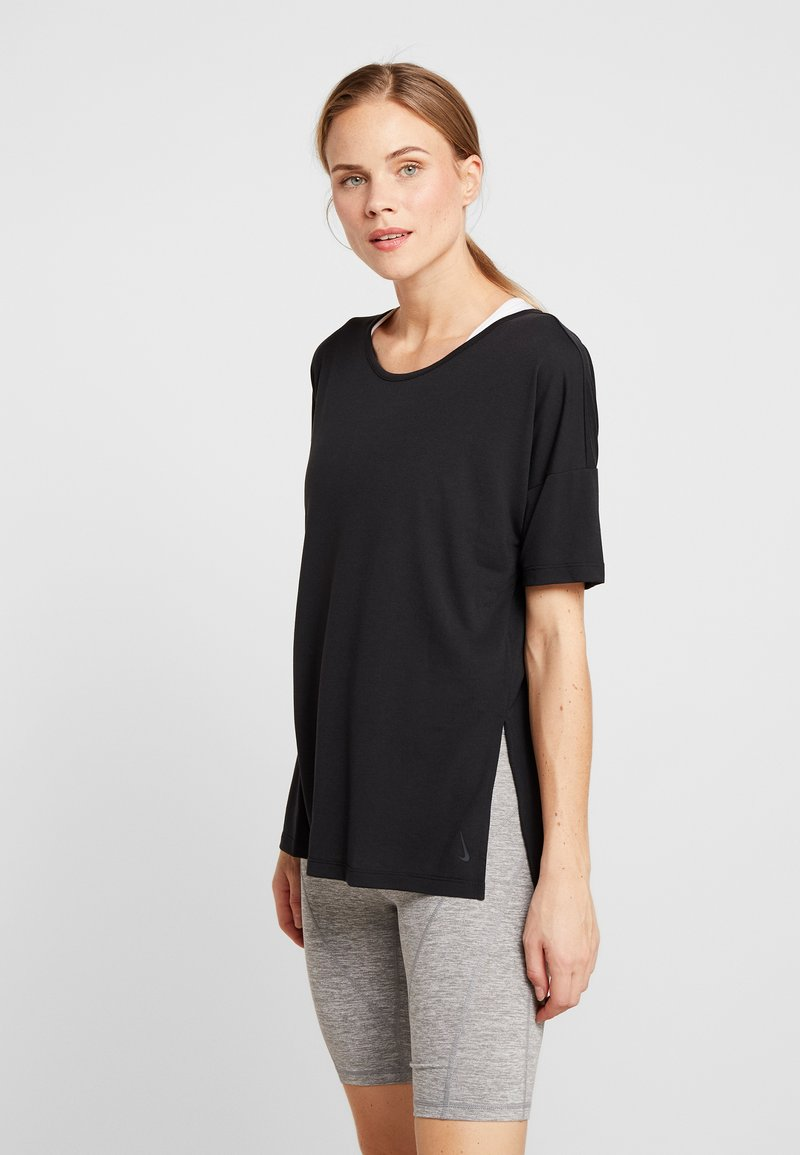 Nike Performance - YOGA LAYER - T-shirts - black