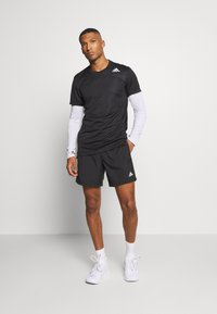 adidas Performance - OWN THE RUN RESPONSE RUNNING  - kurze Sporthose - black - 1
