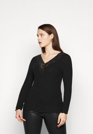 PCSIRI CURVE - Long sleeved top - black