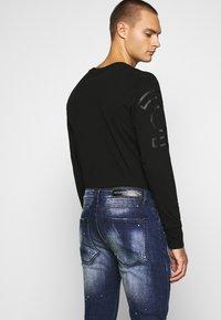 Alessandro Zavetti - MIRANO CARROT FIT - Slim fit jeans - blue - 3