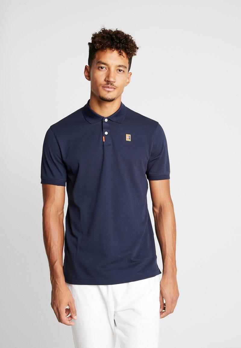 Nike Performance - HERITAGE - Sports shirt - obsidian
