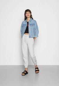 Calvin Klein Jeans - BABY TEE - Print T-shirt - black - 1
