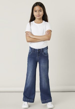 Flared Jeans - medium blue denim