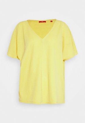 T-shirts - goldgelb