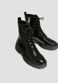 PULL&BEAR - LACKOPTIK - Platform ankle boots - black - 4