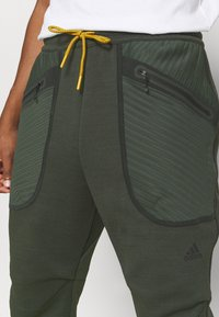 adidas Performance - ATHLETICS TECH COLD.RDY SPORTS PANTS - Pantalones deportivos - dark green - 5