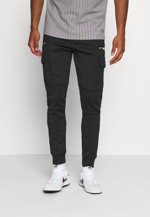 AVELL PANT - Teplákové kalhoty - black