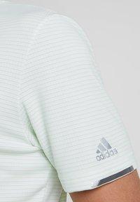 adidas Golf - CLIMACHILL TONAL STRIPE - Sports shirt - glow green/white - 7