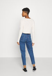Levi's® - HOLLYWOOD WB HW TAPER - Jeans relaxed fit - blue denim
