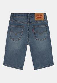 Levi's® - PERFORMANCE  - Denim shorts - stone blue denim - 1