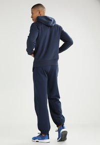 Kappa - SNAKO - Tracksuit bottoms - navy - 2
