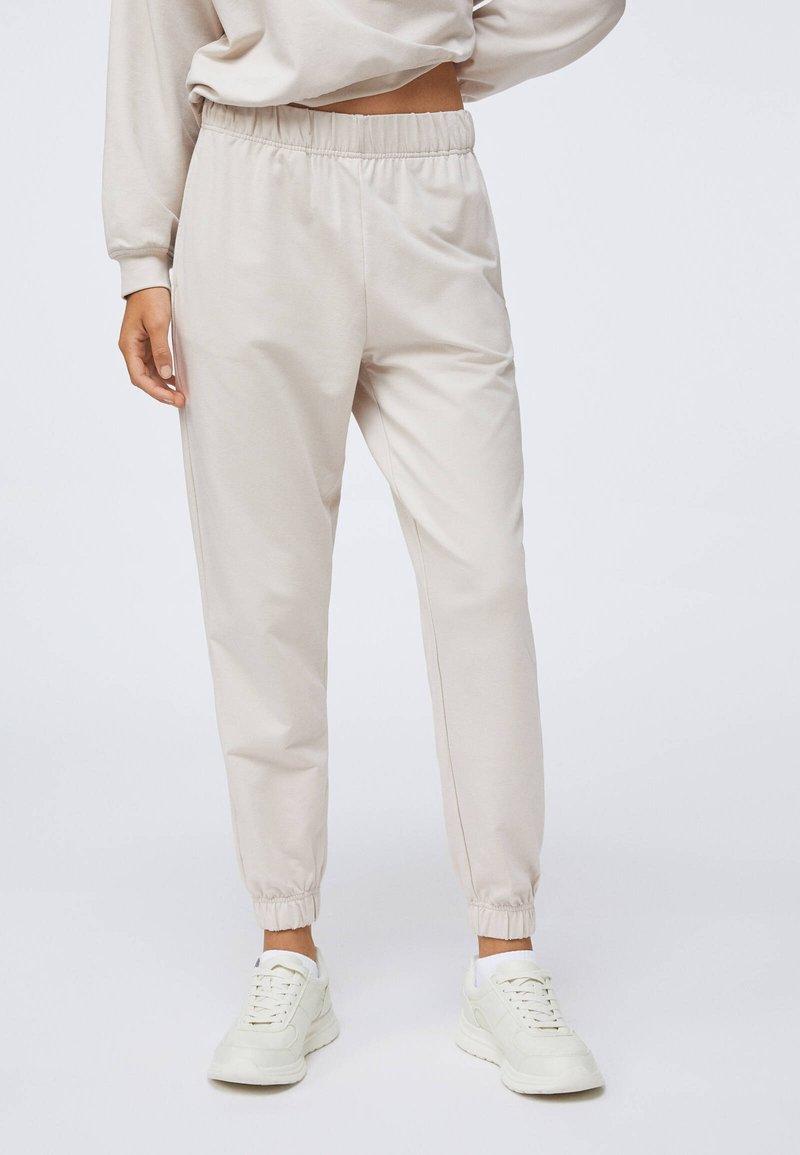 OYSHO - Pantalon de survêtement - beige