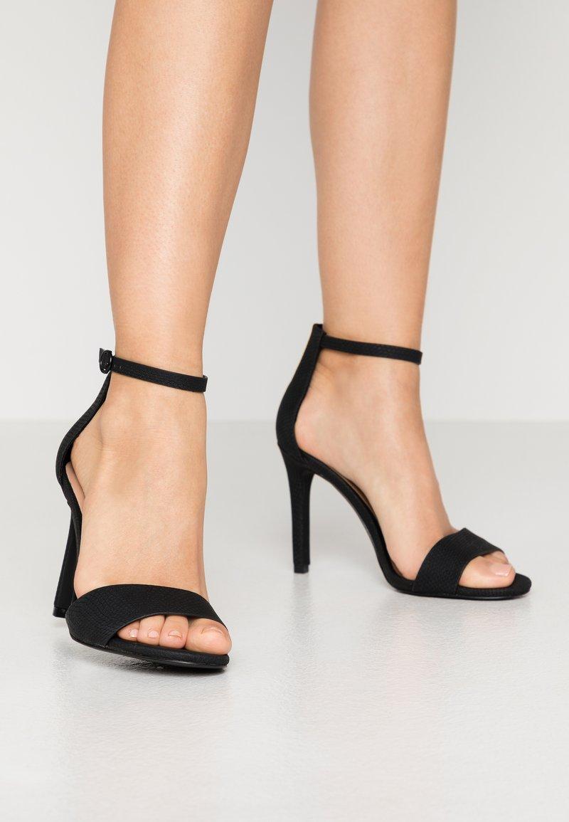 Call it Spring - DELLMAR VEGAN - Korolliset sandaalit - black