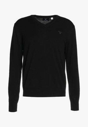 Stickad tröja - schwarz