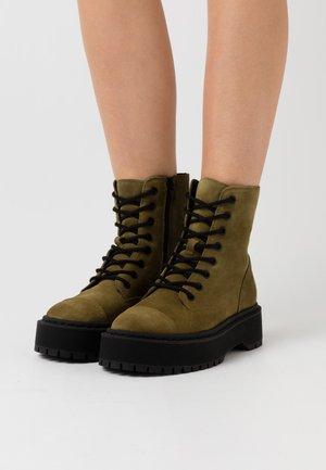 VMPATH BOOT - Platform ankle boots - fir green