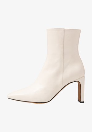 High heeled ankle boots - glacial