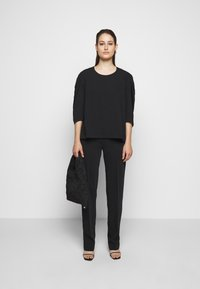 MM6 Maison Margiela - Trousers - black - 1