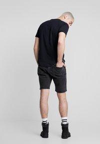 Calvin Klein Jeans - Szorty jeansowe - black with embro - 2