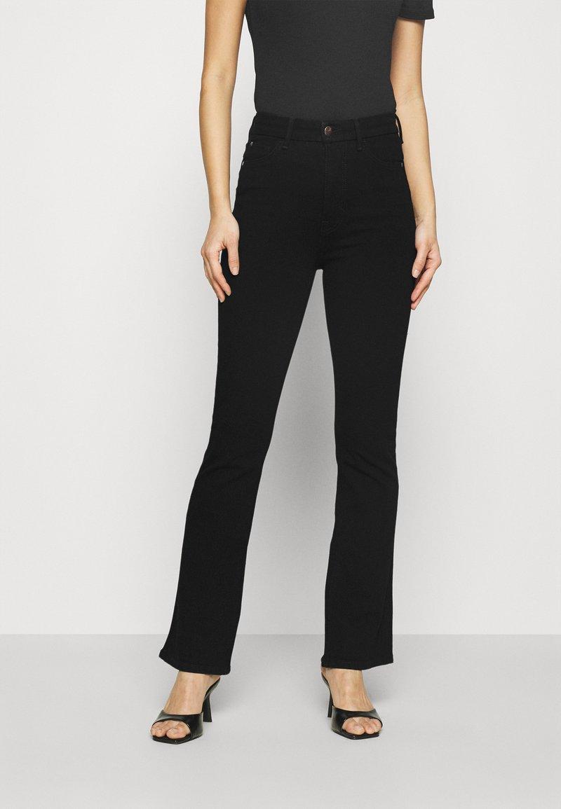 Marks & Spencer London - MAGIC - Bootcut jeans - black denim