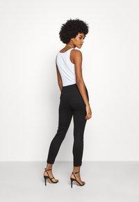 Vero Moda - Leggings - Trousers - black - 2