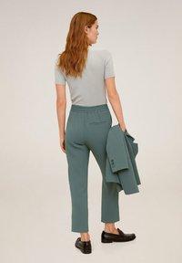 Mango - SEMIFLU - Trousers - grün - 2