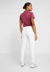 Nike Golf - FLEX  VICTORY - Spodnie materiałowe - white - 2