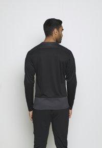 Puma - TEAMGOAL TRAINING  - Fleece jumper - black/asphalt - 2