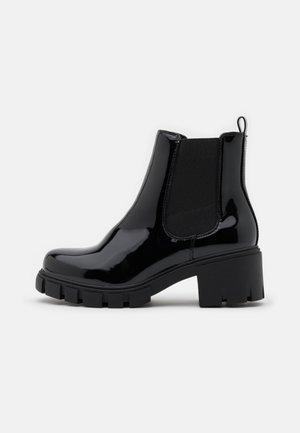 TESSA - Platform ankle boots - black