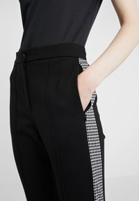 Escada Sport - TAMIANNE - Trousers - black - 4