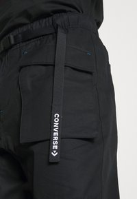 Converse - PANELED JOGGER - Cargo trousers - black - 5