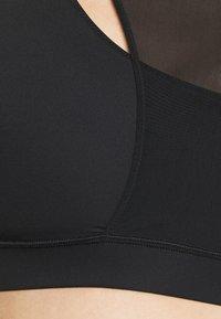 Calvin Klein Performance - MEDIUM SUPPORT BRA - Sujetadores deportivos con sujeción media - black - 5