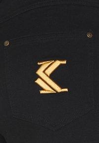 Karl Kani - Denim shorts - black - 6