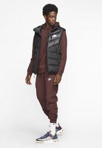 Nike Sportswear - CLUB - Tracksuit bottoms - bordeaux - 1