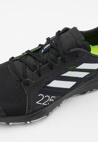 adidas Performance - TERREX SPEED FLOW - Löparskor terräng - core black/crystal white/solar yellow - 5