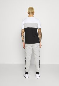 Kings Will Dream - CHAPMAN  - Cargo trousers - grey marl/black/white - 2