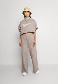 Nike Sportswear - TREND PANT - Tracksuit bottoms - moon fossil - 1