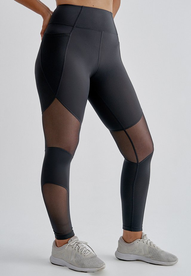 NELU - Leather trousers - black