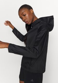 adidas Performance - OWN THE RUN - Training jacket - black