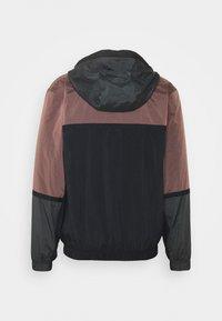 Nike Sportswear - Windbreaker - smokey mauve/dark smoke grey/black - 1