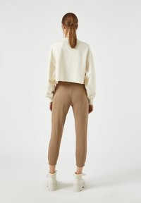 PULL&BEAR - Tracksuit bottoms - brown - 2