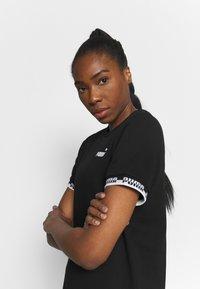 Puma - Robe en jersey - black - 3