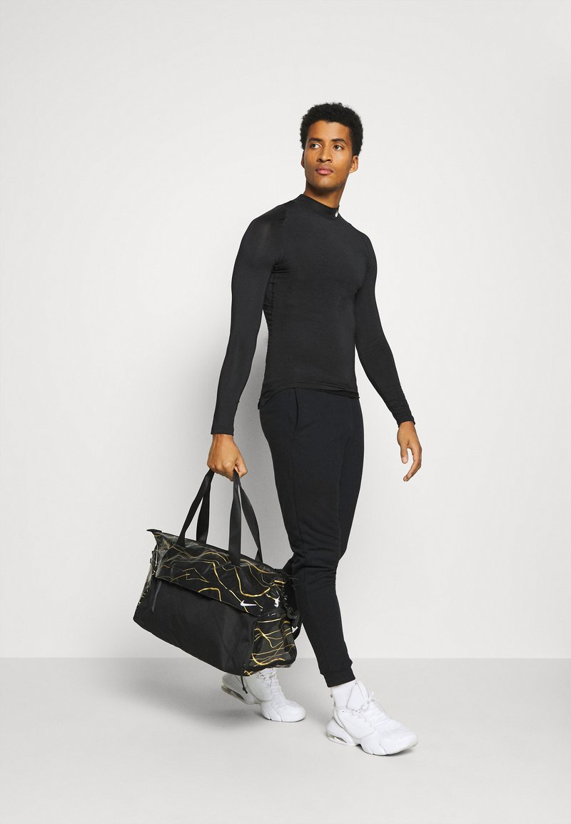 Nike Performance - RADIATE CLUB 2.0 - Sports bag - black/white
