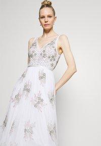 Maya Deluxe - EMBELLISHED BOW BACK DRESS - Společenské šaty - white - 4